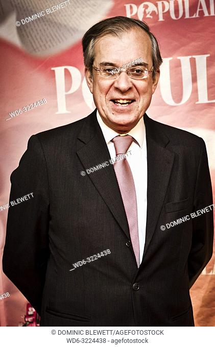 The cinema director poses on the red carpet at the Kino International during French Film Week in Berlin, Germany