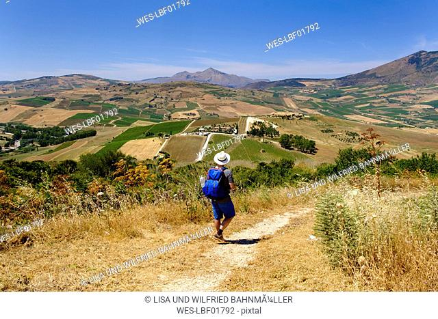 Italy, Province of Trapani, hiker near Segesta