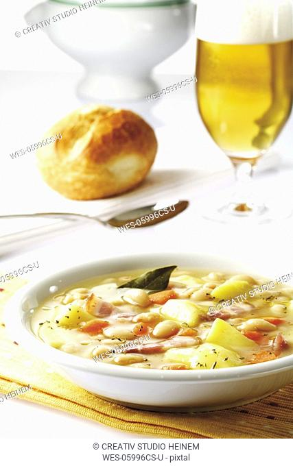 White bean soup with bacon, close-up