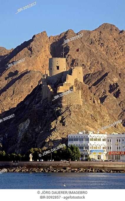 The corniche of Muttrah and the rocky mountains that surround the city at back