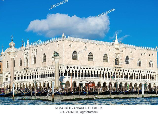 Palazzo Ducale with gondola and blue sky with clouds in Venice Italy