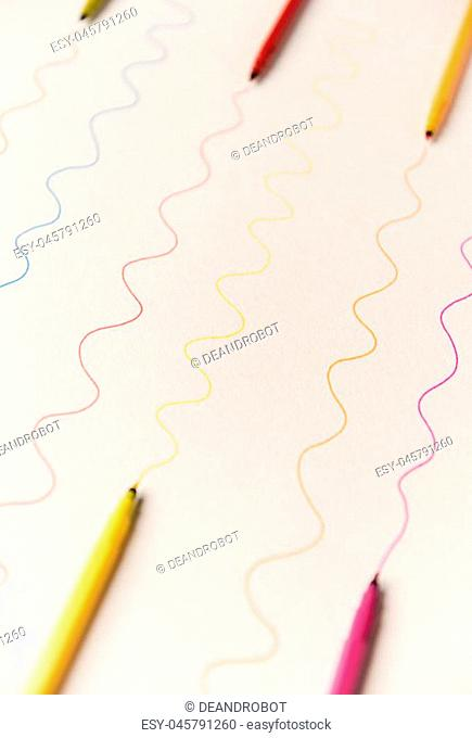Different wavy lines painted with colorful markers on white paper. Lines for logo, text