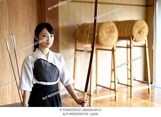 Japanese traditional archery athlete practicing