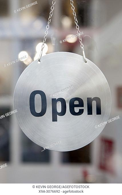 Silver Open Sign on Shop Door