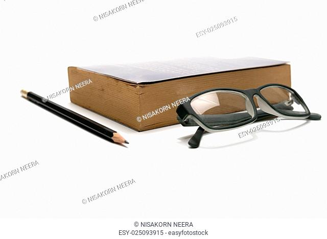 book pencil and eyeglasses