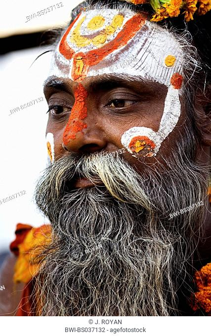portrait of a Sadhu with face painting, India, Varanasi