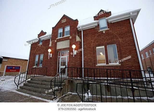 1930 red brick post office in the small town of Kamsack Saskatchewan Canada