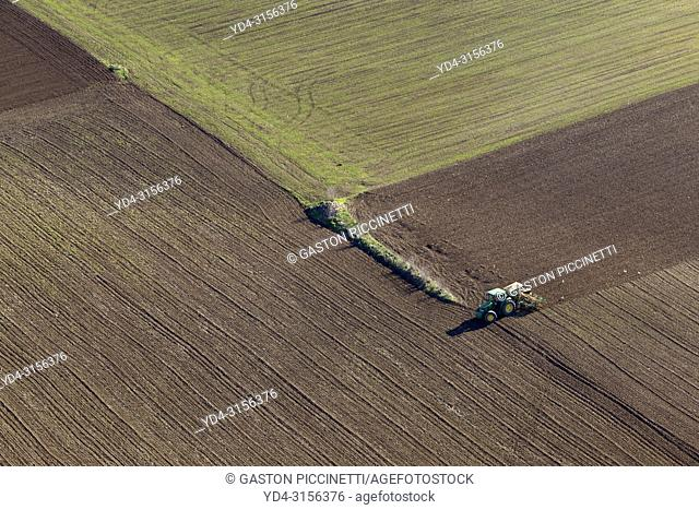 Farm tractor marking in the land, Mallorca, Balearic Island, Spain. Aerial view picture
