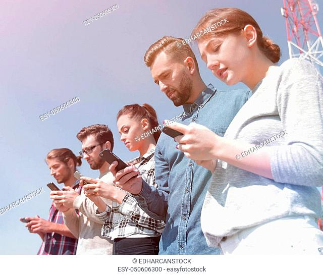 young people using smartphones to search network. photo with copy space