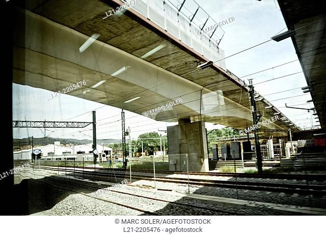 Bridge over railroad tracks. Barcelona province, Catalonia, Spain