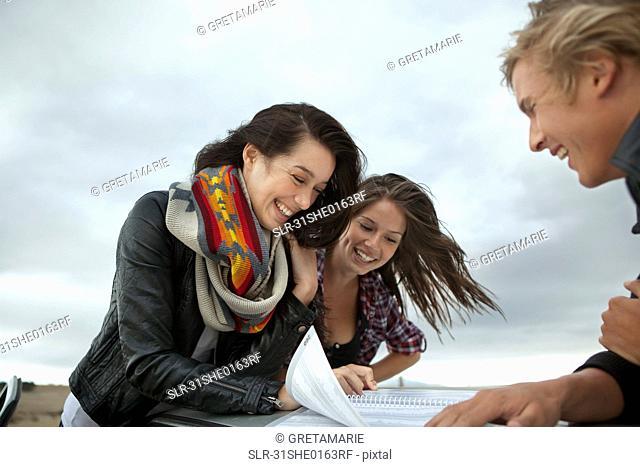 Friends looking in map