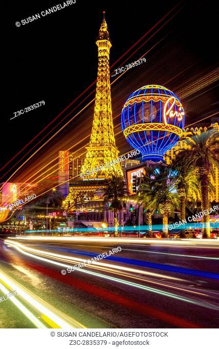 Paris Las Vegas Strip Light Show - Light streaks from vehicular traffic in the Las Vegas Strip in Nevada along with the illuminated Paris Las Vegas Hotel and...