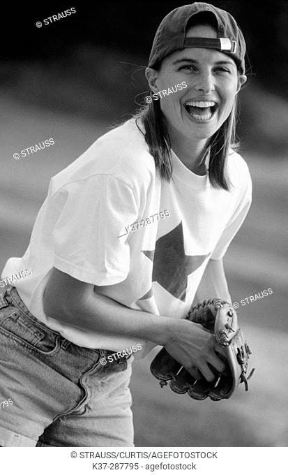Young woman with winning smile and star quality playing in baseball game