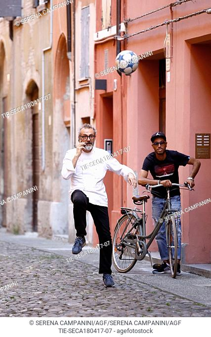 Massimo Bottura, the Chef of the restaurant La Francescana, playing ball in the alley near to his restaurant during a break from work, Modena, ITALY-17-04-2017