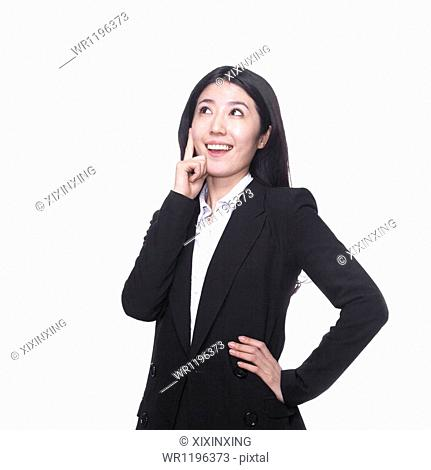 Businesswoman with hand on chin thinking