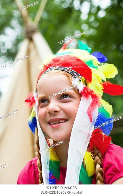 Girl wearing Indian headdress