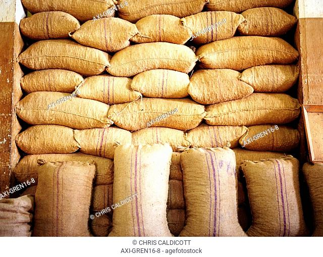 Burlap sacks stacked up in a nutmeg factory