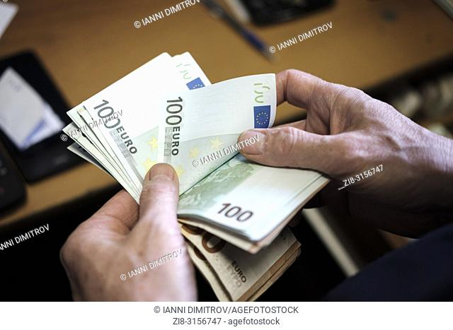 Counting cash-euro banknotes,POV