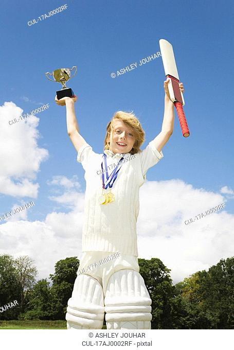 Boy with Cricket Bat, medals and Trophy