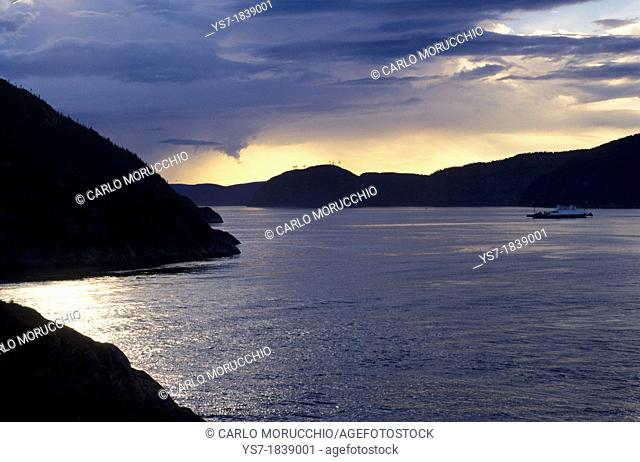 Saguenay fjord at sunset and the ferry to Tadoussac, Quebec, Canada, North America
