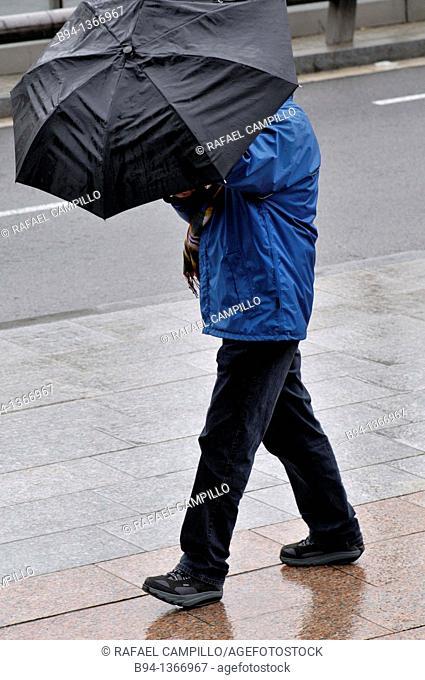 Man with umbrella, Barcelona, Catalonia, Spain