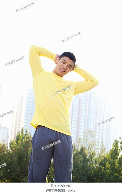 Young Athletic Man Standing in a Park in Beijing