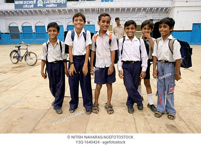 Smiling school children at the end of a school day in Gwalior, India
