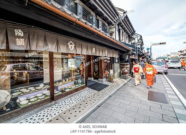 Two women in kimono walking along Kurazukuri Street called Little Edo in Kawagoe, Saitama Prefecture, Japan'