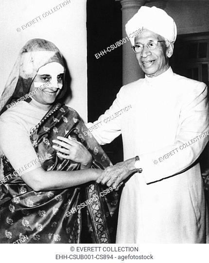 Prime Minister Indira Gandhi, her nose heavily bandaged, recuperating at her home. India's President, Dr. Sarvepalli Radhakrishnan, visited her on Feb