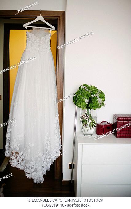Wedding dress hanging on the door of the room