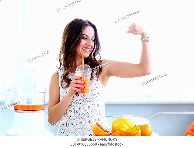 Natural. Cute, curly woman with orange juice