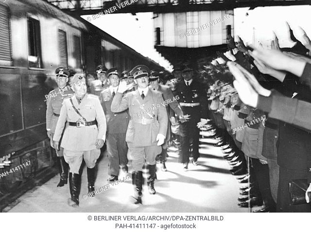 The image from the Nazi Propaganda! shows Adolf Hitler and the Italian Prime Minister Benito Mussolini upon his arrival at Munich Central Station in Germany on...
