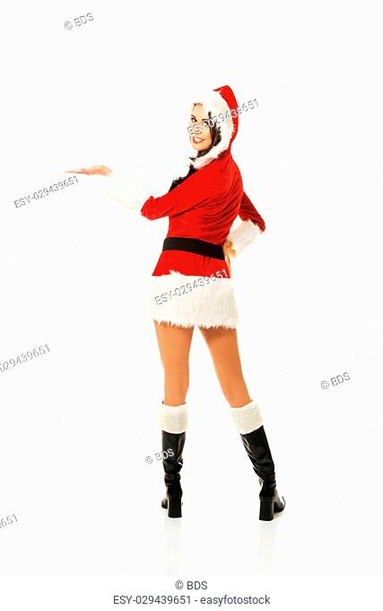 Back view of santa woman holding something invisible on the right hand