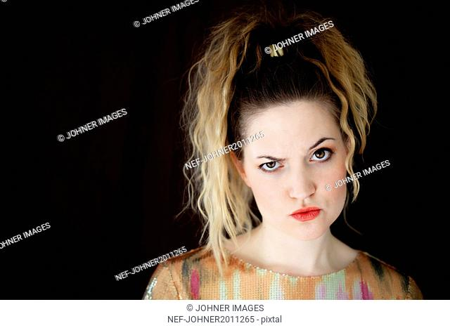 Portrait of young woman making face