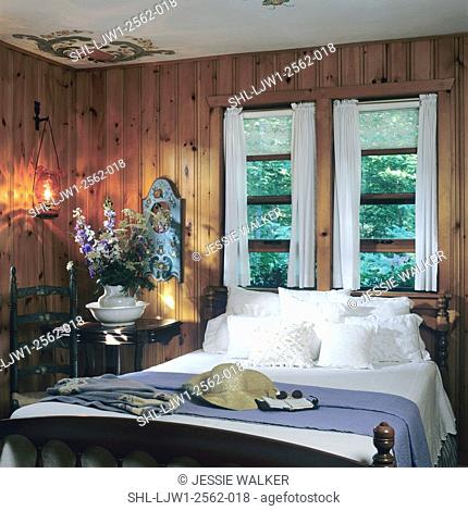 BEDROOMS - In log cabin, charming, wood paneled, Norwegian theme, hand painted scrolls and flowers painted in each ceiling corner, white linens , blue throw