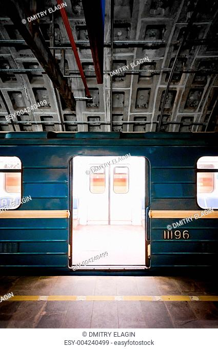 Subway train in dark tunnel