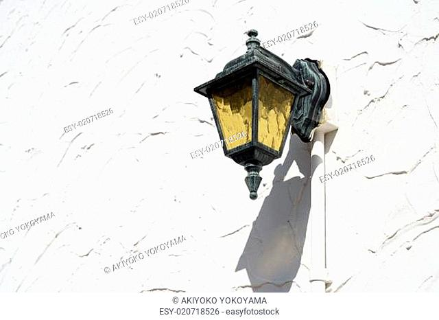 Old lamp lantern on the white wall