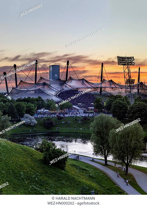 Germany, Bavaria, Munich, View of Olympic stadium at sunset