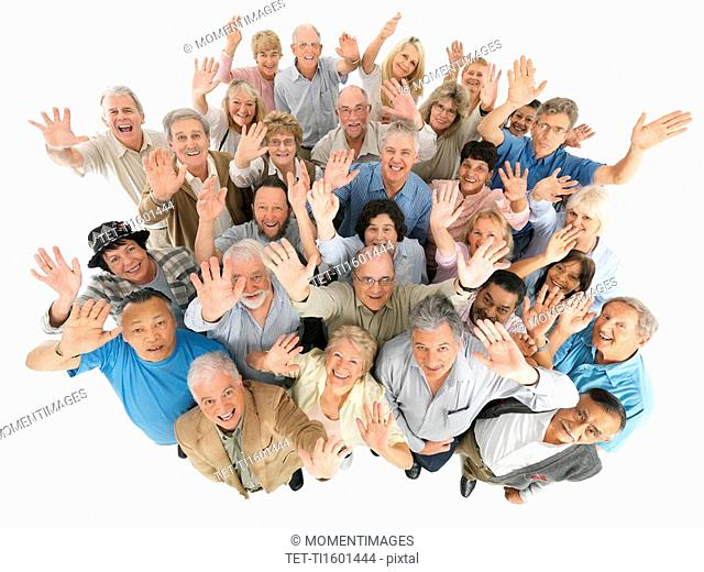A group of people waving while looking up