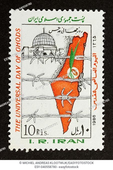 IRAN - CIRCA 1970: Stamp printed in Iran shows an map of Israel behind barbed wire, circa 1970