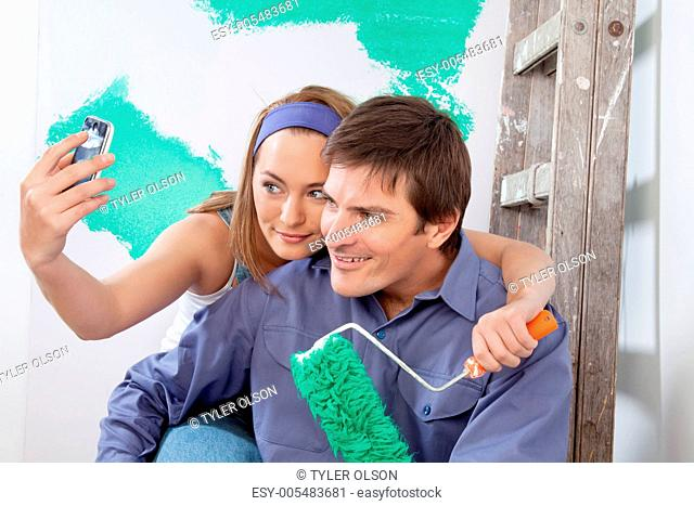 Happy couple taking a snapshot of themselves