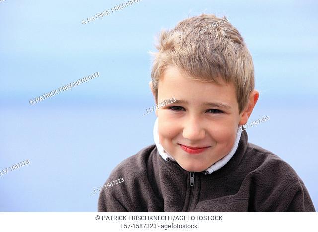 boy sitting on seacoast