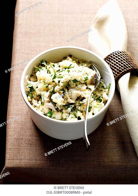 Bowl of rice and fish salad