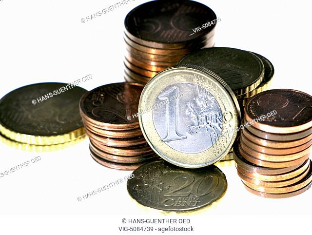 16.12.2014, Unkel, DEU, Germany, one EURO coin in front of stacked coins - Unkel, Rhineland-Pala, Germany, 16/12/2014