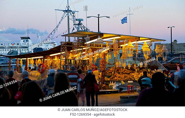 Souvenir shops and seafood at the commercial port, City of Rhodes, Rhodes Island, Dodecanese, Greece, Mediterranean Sea