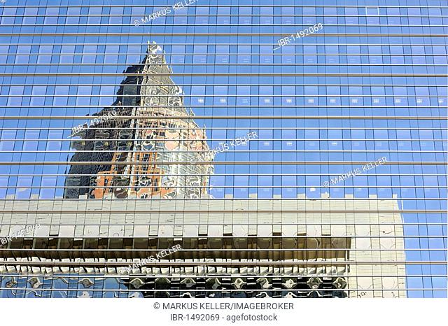 The top of the fair tower, Messeturm, and an office building reflected in the glass facade of an office skyscraper in the Frankfurt financial district