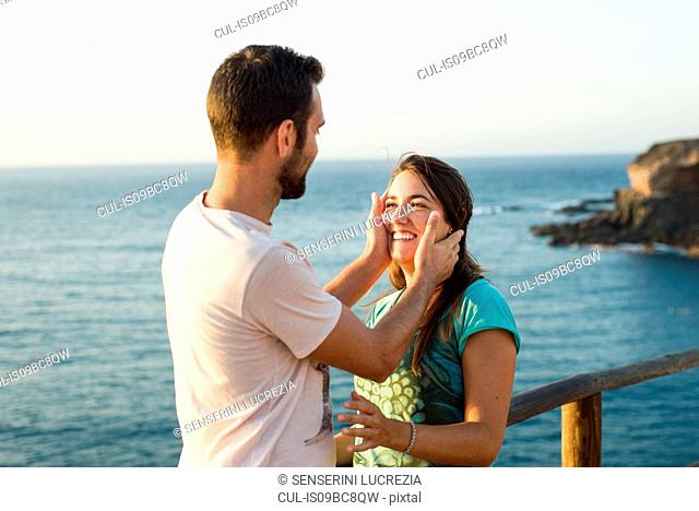 Couple laughing by seaside, Corralejo, Fuerteventura, Canary Islands