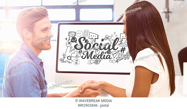 Digital composite image of graphics on computer screen with couple holding hands
