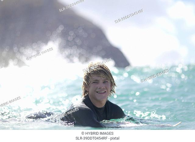 Surfer paddling in water