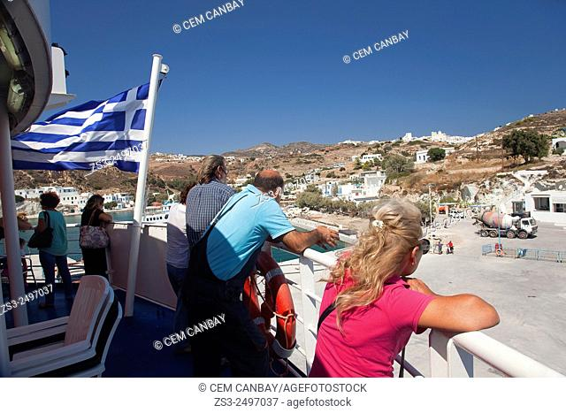 Tourists looking from the ferry deck, Sifnos, Cyclades Islands, Greek Islands, Greece, Europe